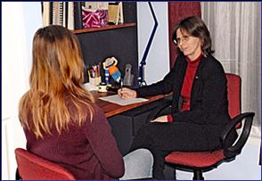 Helen Davies consulting a client.